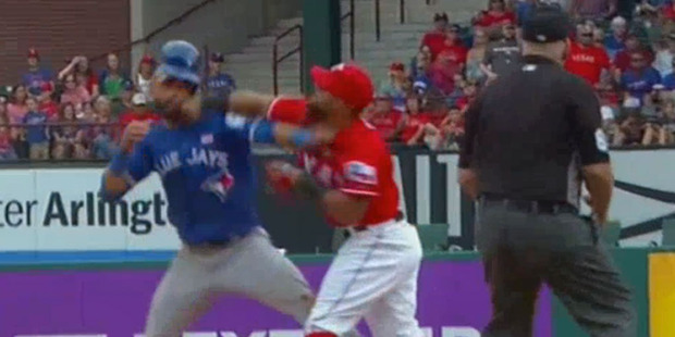 The Blue Jays and Rangers brawled in the eighth inning of their game this morning after Jose Bautista went in to second base hard on a takeout slide. Photo / YouTube.
