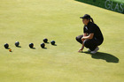 Mandy Boyd examines the bowls during the Commonwealth Games. Photo / Getty Images