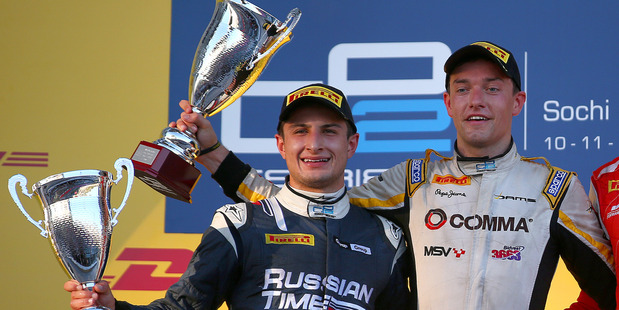 Mitch Evans celebrates on the podium at the Russian Grand Prix. Photo / Getty Images