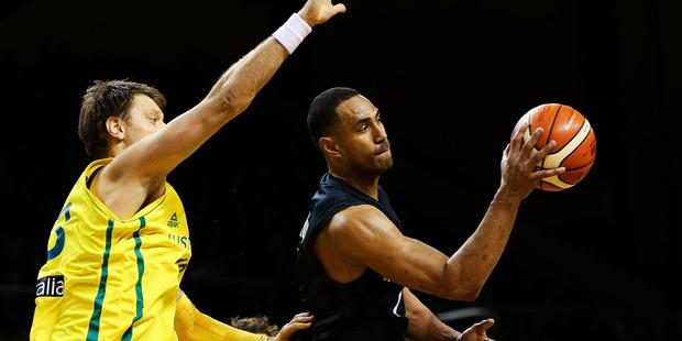 Mika Vukona of the Tall Blacks passes against Australia. Photo / Getty Images