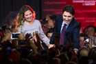 Justin Trudeau, Canada's Prime Minister and his wife Sophie Gregoire-Trudeau greet supporters on election night. Photo / AP