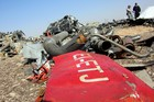 Egyptian officials inspect the crash site of Russian Airliner in Suez, Egypt, in November last year. Photo / Getty Images