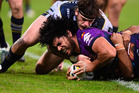 Tohu Harris crashes over for a try for the Melbourne Storm during their tight win against the North Queensland Cowboys last night. Photo / Getty Images
