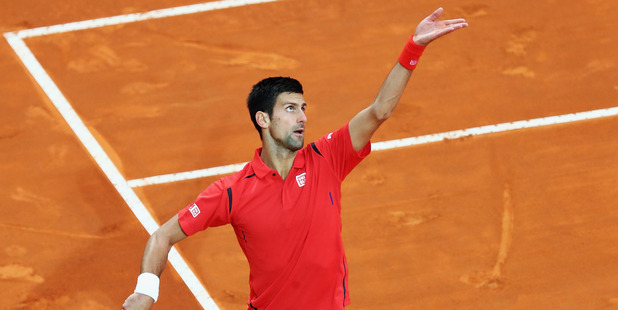 Novak Djokovic earned less income than womens champion Angelique Kerber during the Australian Open. Photo / Getty Images
