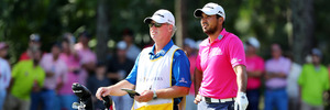 Jason Day and caddie Colin Swatton chat during the PLAYERS Championship. Photo / Getty Images