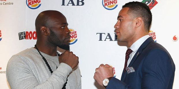 Carlos Takam and Joseph Parker pose during their press conference. Photo / Getty