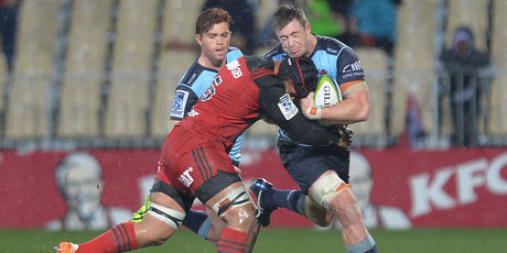 Jed Holloway of the Waratahs is tackled by Jordan Taufua of the Crusaders. Photo / Getty