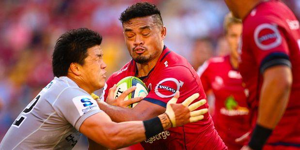 Queensland Reds player Hendrik Tui is tackled by Harumichi Tatekawa. Photo / Getty