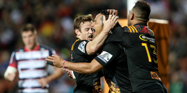 The Chiefs celebrate Toni Pulu's try during their win over the Rebels. Photo / Getty