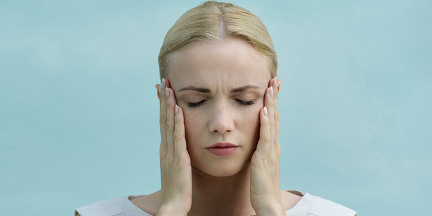 Migraines lead to more sick days than any other illness. Photo / Getty