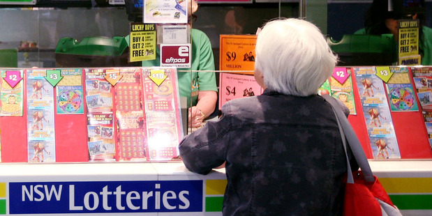 The syndicate who won a $2.85 million split of the total $40,445,165 prize draw have just two days to resolve a dispute before the money is handed out. Photo / Bloomberg