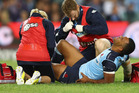Kurtley Beale of the Waratahs grimaces as he receives attention for an injury. Photo / Getty Images.