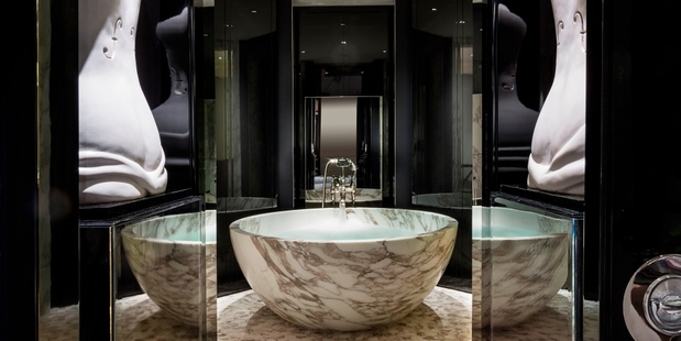 The hotel's Manor House suite is fitted with an expansive Italian marble master bathroom and a guest powder room. Photo / Rosewood Hotel