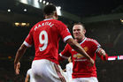 Wayne Rooney (R) celebrates scoring with team mate Anthony Martial (L). Photo / Getty