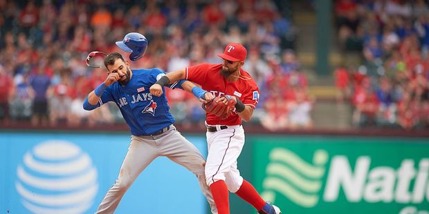 Texas Rangers Rougned Odor (R) landing punch vs Toronto Blue Jays Jose Bautista (L). Photo / Getty