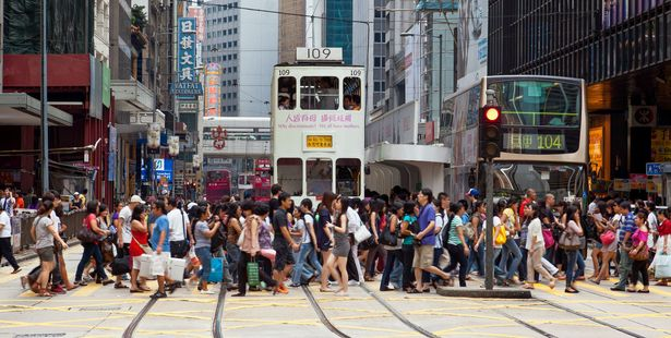 Pedestrians crossing a busy crosswalk in Central, Hong Kong. Photo / 123RF