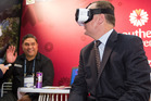 John Key tries out a virtual reality headset at TRENZ in Rotorua.  Photo/Stephen Parker