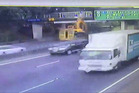A video still of the moment of impact, when the digger arm hit the Penrose overbridge.