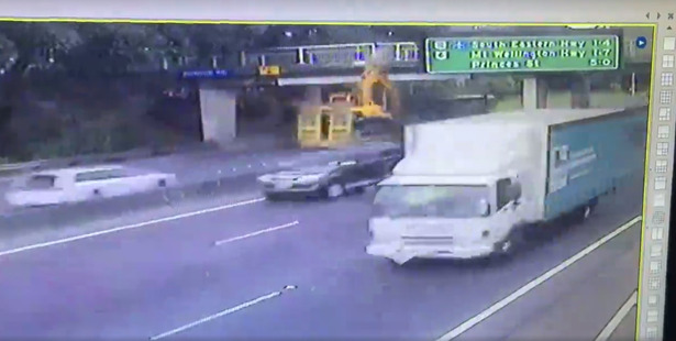Loading A video still of the moment of impact, when the digger arm hit the Penrose overbridge.