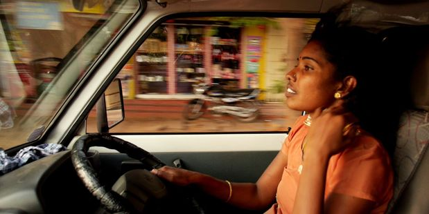 Selvi at work as a cab driver in Driving with Selvi