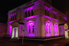 AGLOW: The former Cosmopolitan Club building at the corner of Drews Ave and Rutland St is lit up at night.