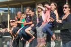 From right, Patricia Buchanan, Lucy Bicknell, 6, Kaydence Marsden, 8, Lucy Martin, 8,  birthday girl Kyla Bicknell, 9, Greer van den Broek, 8, Cooper Bicknell, 4, and Summer Vari, 8, get into the action at Arawa Park Cup Day. Photo / Stephen Parker