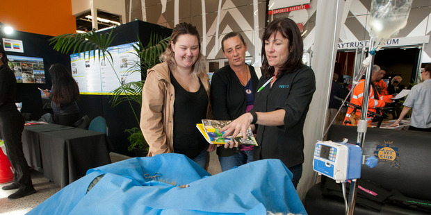 CHOICES: Amy Wilson (left) and Angela Wilson (centre) discuss veterinary work with Vetora vet nurse and administrator Rebecca Baldwin (right) at the Rotorua Careers Expo. PHOTO/BEN FRASER