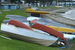 Catamarans and dingys were flipped and damaged in high winds last night along Pilot Bay. Photo/John Borren