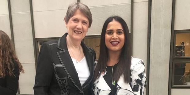 Aspiring human rights lawyer Rez Gardi, came to New Zealand from Pakistan as a refugee, meets Helen Clark in Copenhagen. Photo / Supplied