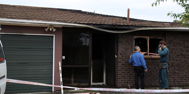 TRAGEDY: A woman was pulled alive from this Whanganui house after it caught fire last month, but later died from her injuries. The house had a smoke alarm but there was no battery in it.