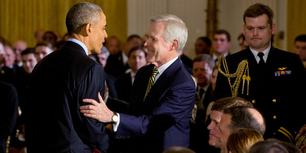 President Barack Obama greets Navy Secretary Ray Mabus in the East Room of the White House in Washington, on Wednesday, April 27, 2016. Photo / AP