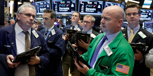 Traders gather at the New York Stock Exchange. File photo / AP