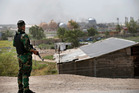 A federal police man stands guard outside the natural gas plant in Taji. Photo / AP
