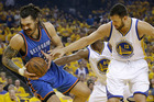 Oklahoma City Thunder center Steven Adams, left, is guarded by Golden State Warriors center Andrew Bogut during the first half of Game 1. Photo / AP.