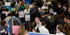 A long line of travellers wait for the TSA security check point at O'Hare International airport in Chicago. Photo / AP