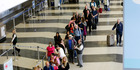 A long line of travelers wait for the TSA security check point at O'Hare International Airport in Chicago. Photo / AP