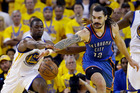 Steven Adams fights for a loose ball against Harrison Barnes during game one. Photo / AP