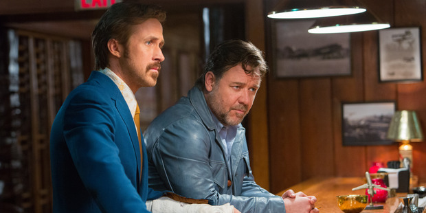 Ryan Gosling as Holland March and Russell Crowe as Jackson Healy in the film The Nice Guys. Photo / AP