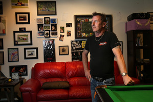 Phil Rudd in his 'man cave&'; which houses rock memorabilia, framed photos and awards, a pool table and his drum kit. Photo/John Borren