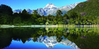 Mt Madeline reflected off the water at Lake Alabaster north of Pyke Lodge. Photo / Ngai Tahu Tourism Holdings