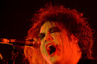 The Cure front man Robert Smith sings to a packed house at the Vector Arena Auckland. Photo / Richard Robinson