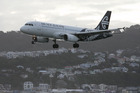 An Air NZ Airbus A320 lands at Wellington. There's tougher competition for Air NZ on the international front, but this is feeding more passengers into its domestic business.  Photo / Mark Mitchell