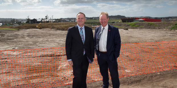 Prime Minister John Key with Minister of Building & Housing Nick Smith at the launching of the new affordable housing development at Hobsonville Point, Auckland, last month. Photo / Brett Phibbs
