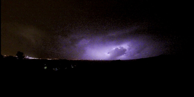 Lightning to north of Auckland at about 8pm on Monday. Photo: Matthew Davison