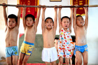 Children practice during a gymnastics summer school on July 28, 2015 in Bozhou, Anhui Province of China. (Photo by ChinaFotoPress/ChinaFotoPress via Getty Images.