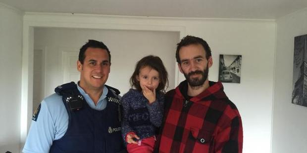 Sergeant Craig Curnow (left) with four-year-old Hailey Alver and her father Chris Alver.