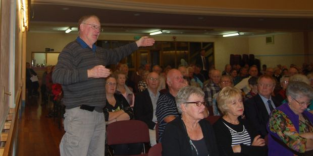 A senior citizen asks about improving the train service for Supergold card users at a public meeting hosted by the Office for Seniors at the Masterton Town Hall on Monday. PHOTO/ALISA YONG