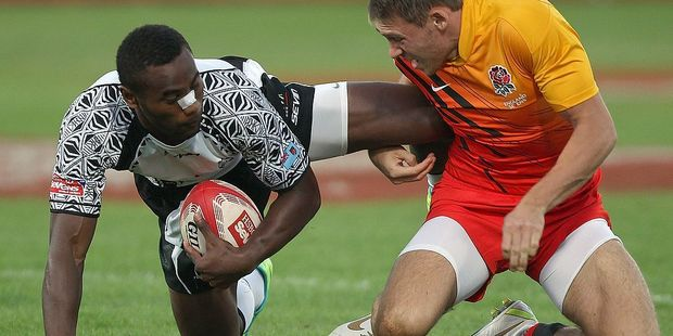 Semi Radradra (L) playing for Fiji during the Dubai Rugby Sevens World Series semi-final in 2011. Photo / Getty