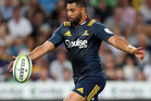 Lima Sopoaga of the Highlanders looks to kick the ball during the round two Super Rugby match. Photo / Getty Images.