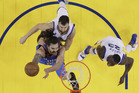 Oklahoma City Thunder's Steven Adams, bottom left, drives past Golden State Warriors' Andrew Bogut, top left, and Draymond Green. Photo / AP